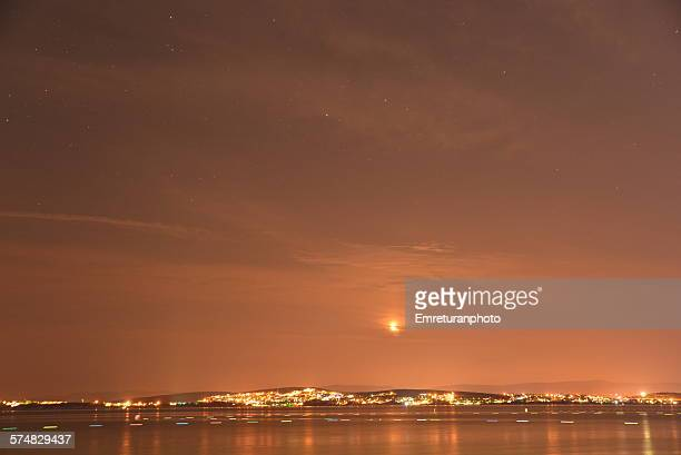 moon rising above cesme sky - emreturanphoto stock pictures, royalty-free photos & images