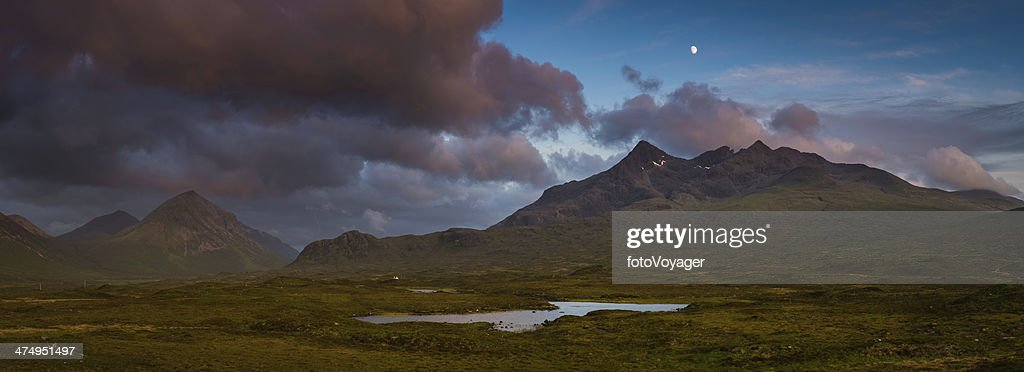 Moon rising over epic mountain landscape stormy sunset panorama Scotland : Stock Photo