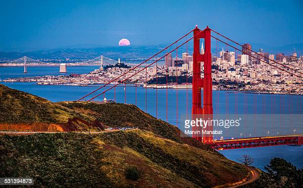 moon rising - oakland bay bridge stock pictures, royalty-free photos & images