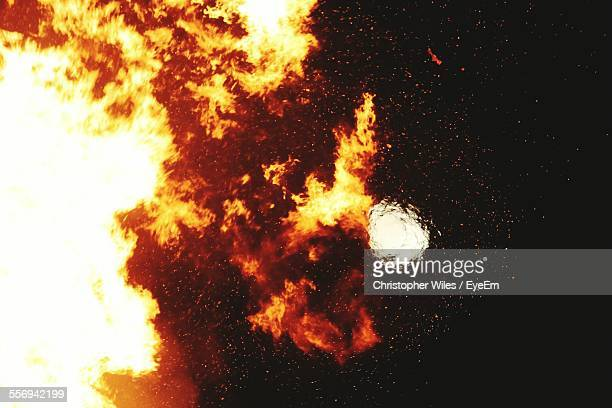 moon seen through raging fire - furious stock pictures, royalty-free photos & images