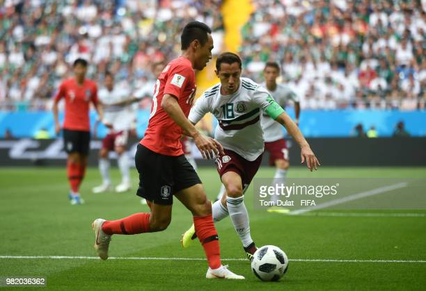 Moon SeonMin of Korea Republic challenge for the ball with Andres Guardado of Mexico during the 2018 FIFA World Cup Russia group F match between...