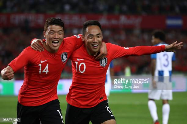 Moon SeonMin of South Korea celebrates after scoring a second goal with his team mate Hwang HeeChan during the international friendly match between...