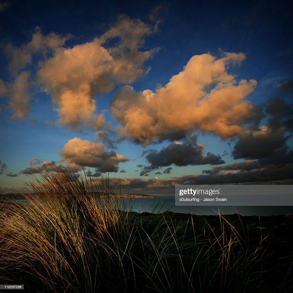 Moon sets over St Ives : Stock Photo
