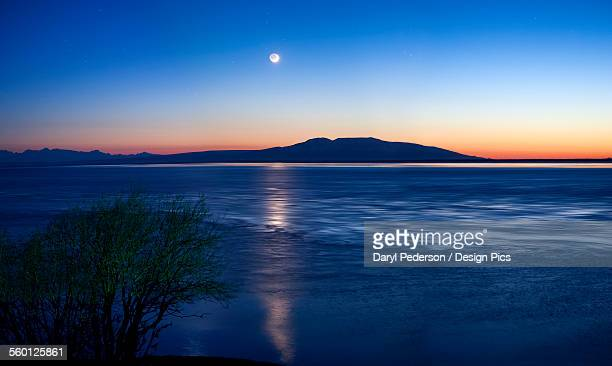 moon setting over mt. susitna, also known as sleeping lady, west of anchorage - mt. susitna stock pictures, royalty-free photos & images