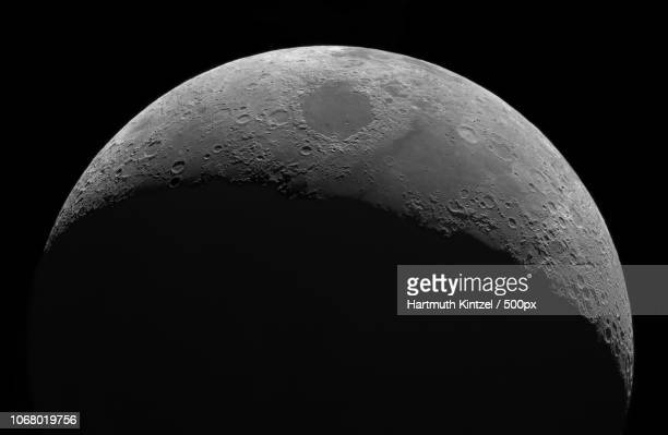 moon shrouded in darkness - moon stock pictures, royalty-free photos & images