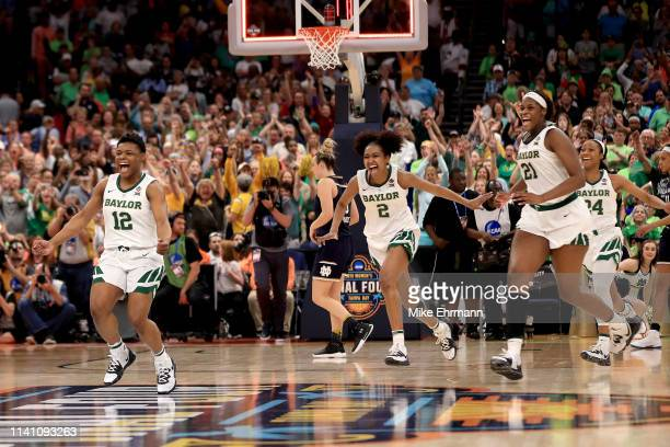 Moon Ursin, DiDi Richards and Kalani Brown of the Baylor Lady Bears celebrate their 82-81 win over the Notre Dame Fighting Irish to win the...