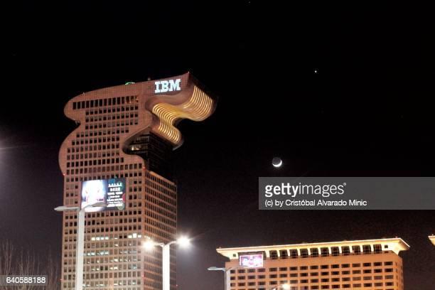 moon, venus, mars and ibm dragon building, beijing. - stadio olimpico nazionale foto e immagini stock