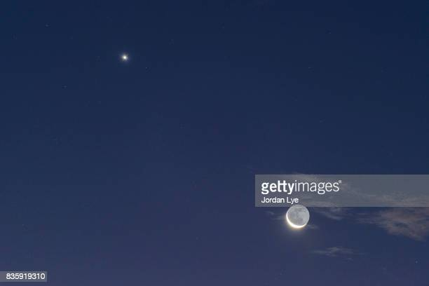 moon with earth shine and venus - mini moon stock pictures, royalty-free photos & images