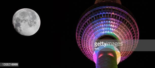 moon with television tower berlin - national landmark stock pictures, royalty-free photos & images