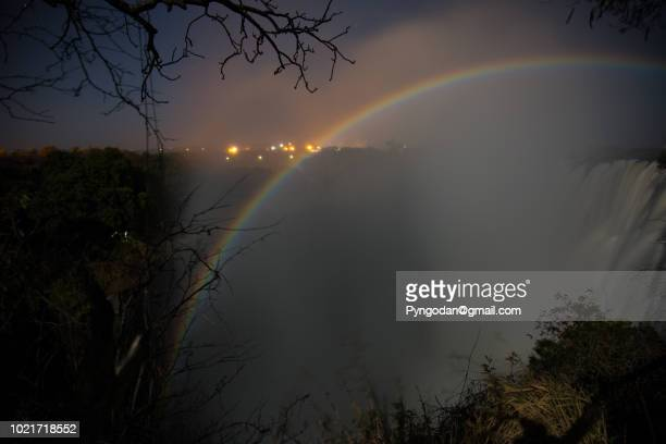 moonbow appearing over the victoria falls at night at zambia - moonbow ストックフォトと画像