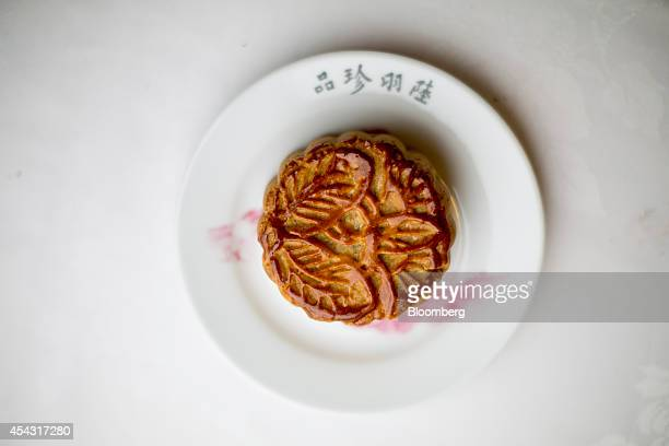 A mooncake sits on a plate in an arranged photograph inside Luk Yu Tea House in Hong Kong China on Thursday Aug 28 2014 The midautumn festival will...