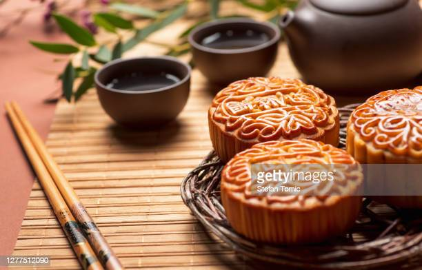 mooncake traditional chinese pastry served with tea for mid autumn day festival - moon cake stock pictures, royalty-free photos & images