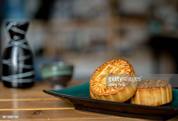 Mooncakes on table On September 15 Chinese people will celebrate 2016 MidAutumn festival by getting together with their families and eating mooncakes...