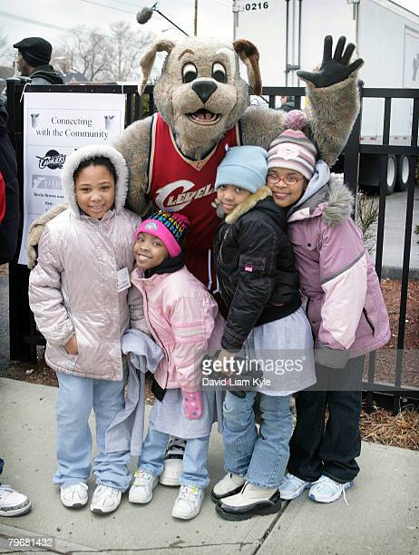 Moondog, mascot of the Cleveland Cavaliers, poses with children as Cleveland Cavalier players distribute food on February 9, 2008 at the Bethany...