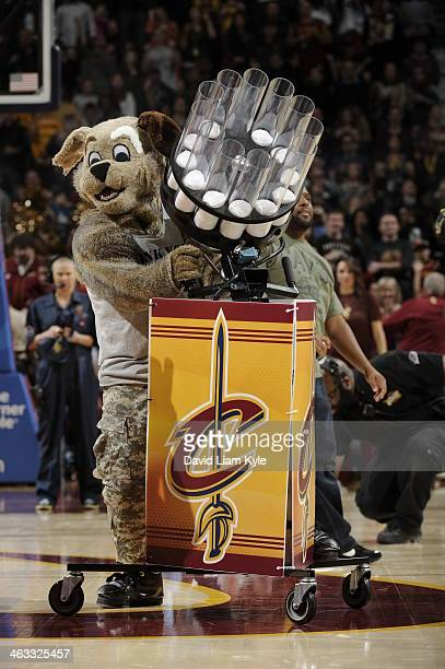 Moondog Mascot of the Cleveland Cavaliers shoots towels in the crowd against the Philadelphia 76ers at The Quicken Loans Arena on November 9, 2013 in...