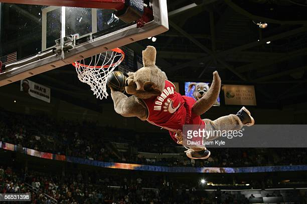 Moondog, the Cavs mascot, performs a power dunk for the audience during a game between the New Jersey Nets and the Cleveland Cavaliers at Quicken...