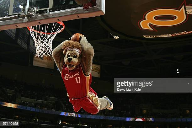MoonDog, the mascot of the Cleveland Cavaliers, performs a power dunk during a game between the Orlando Magic and the Cleveland Cavaliers at Quicken...