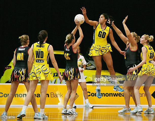 Mo'onia Gerrard of the Swifts jumps high to block the shot of Belinda Dever of the Firebirds during the week five Commonwealth Bank Trophy match...