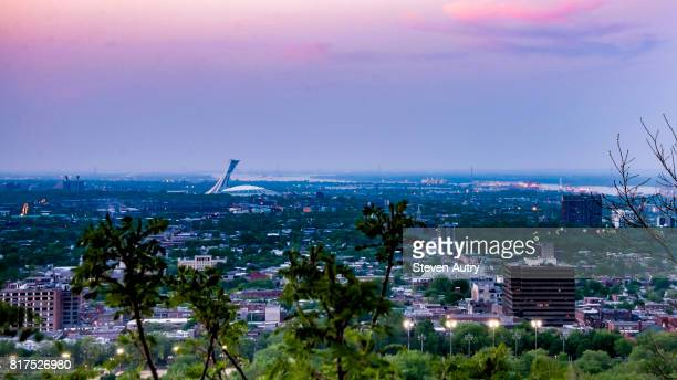 moonlight blues - montreal olympic stadium stock photos and pictures