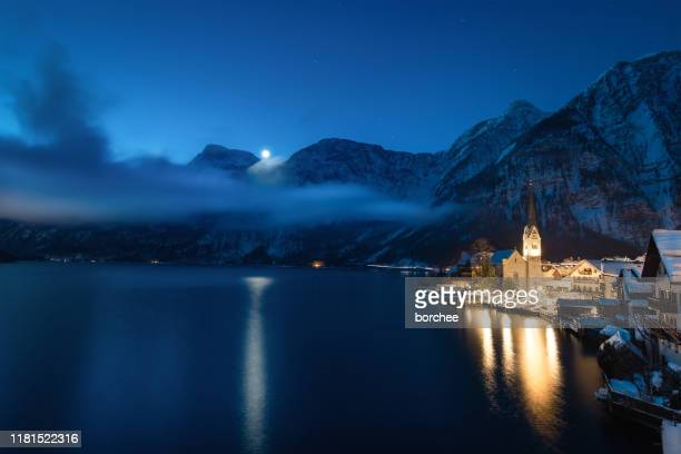 moonlight in hallstatt - december stock pictures, royalty-free photos & images