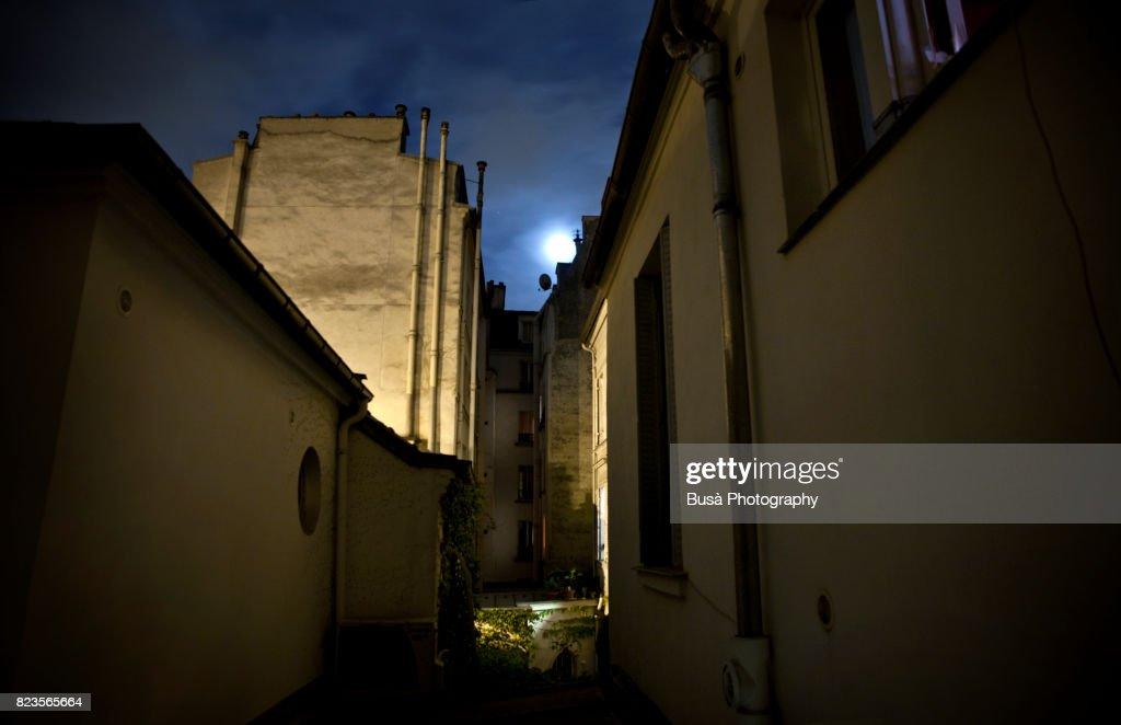 Moonlight in the sky between old buildings, Paris, France : Stock Photo