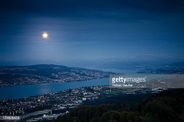 moonlight over lake - tobias gaulke stock-fotos und bilder