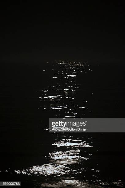 Moonlight reflected by water at night