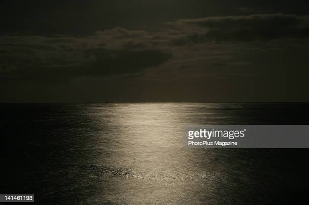 Moonlight reflected on the calm waters around Portland Bill lighthouse on the Isle of Portland, taken on August 24, 2010.