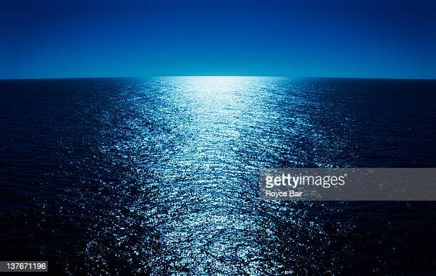 moonlight reflecting across ocean - moonlight stock pictures, royalty-free photos & images