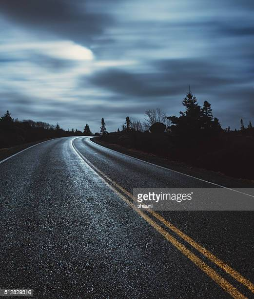 moonlit coastal road - wet stock pictures, royalty-free photos & images