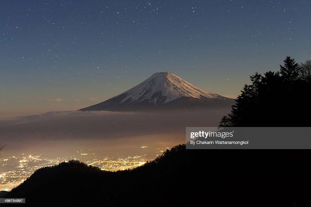Moon-lit Fuji and the town of Kawaguchiko : Stock Photo