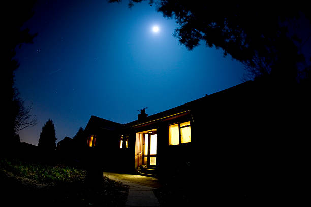 moonlit house - house night stock pictures, royalty-free photos & images