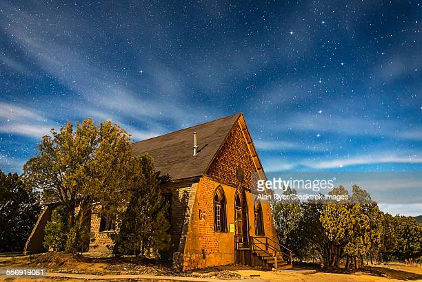 A moonlit nightscape of the historic Hearst Church in Pinos Altos, New Mexico.