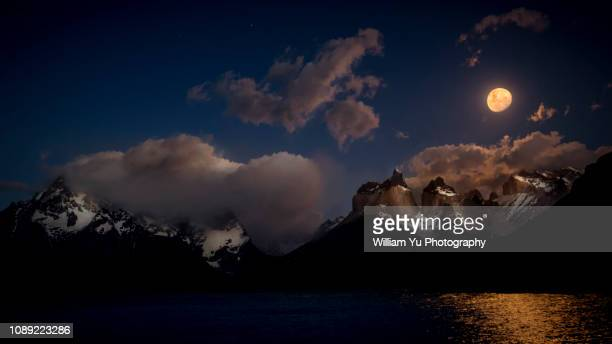 moonlit peaks at torres del paine national park - william moon stock pictures, royalty-free photos & images