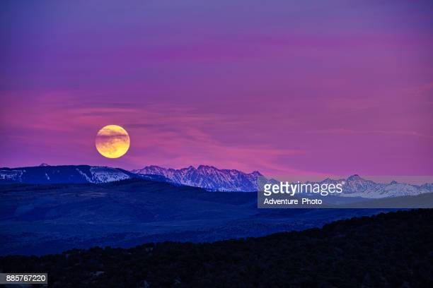 moonrise and scenic mountains at sunset eagle colorado - pink moon stock pictures, royalty-free photos & images