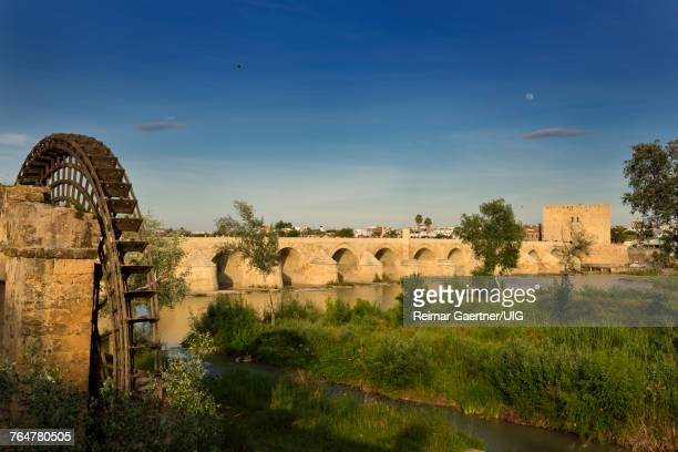 Moonrise over Guadalquivir River with Albolafia Waterwheel Roman Bridge and Calahorra Tower Cordoba