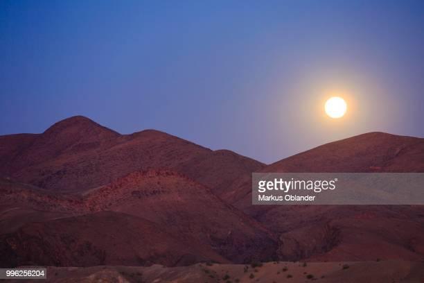 Moonrise over the mountains, full moon, Purros, Kunene region, Namibia