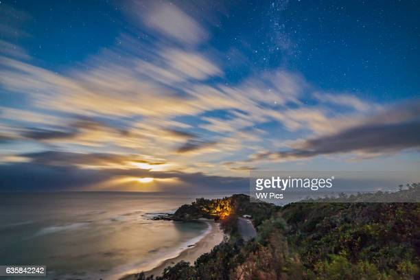 Moonrise over the Pacific Ocean with the Moon lighting the clouds and sky over Shelly Beach at Nambucca Heads New South Wales Australia The Southern...