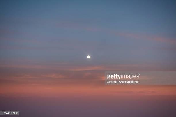 Moonrise over twilight sky