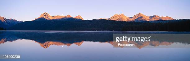 Moonset at sunrise over Redfish Lake and Sawtooth Mountains