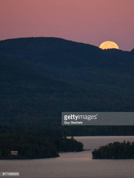 moonset over moosehead lake - moosehead lake stock photos and pictures