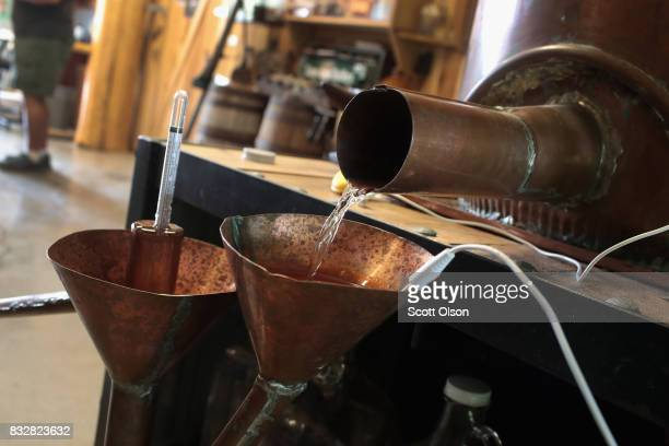 Moonshine runs from the still at Casey Jones Distillery on August 16, 2017 in Hopkinsville, Kentucky. To celebrate the upcoming total eclipse Casey...
