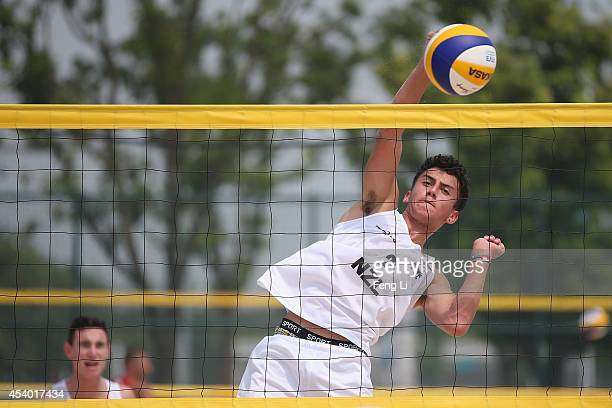 Moore and Robinson of New Zealand compete during their match against Rudolf and Stadie of Germany in Beach Volleyball Men Pool B match during the...