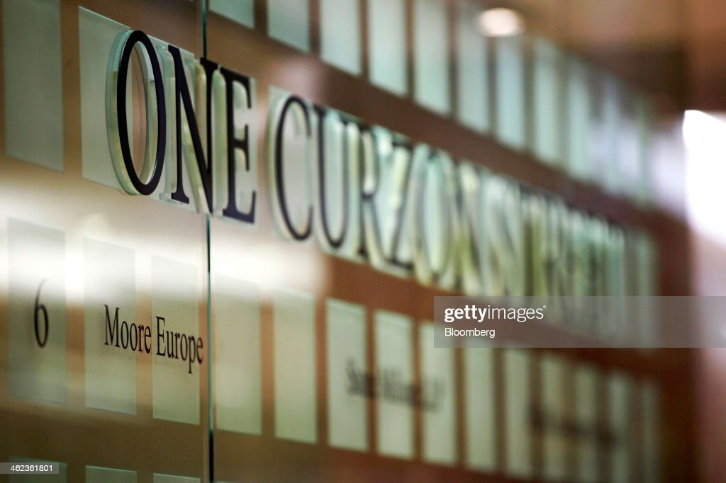 A Moore Europe logo sits on a sign inside One Curzon Street, a