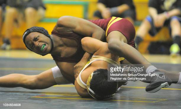 BEACH Moore League wrestling between Poly and Wilson at Poly High 120 pound match Wilson's Elijah Hawkins beat Poly's Samdey Em