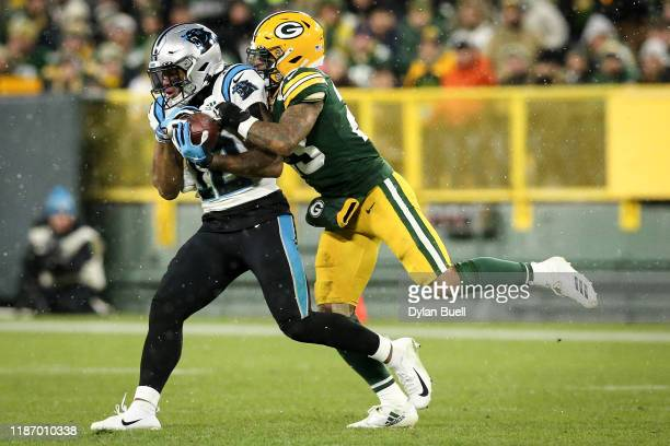 J Moore of the Carolina Panthers makes a catch while being guarded by Jaire Alexander of the Green Bay Packers in the third quarter at Lambeau Field...