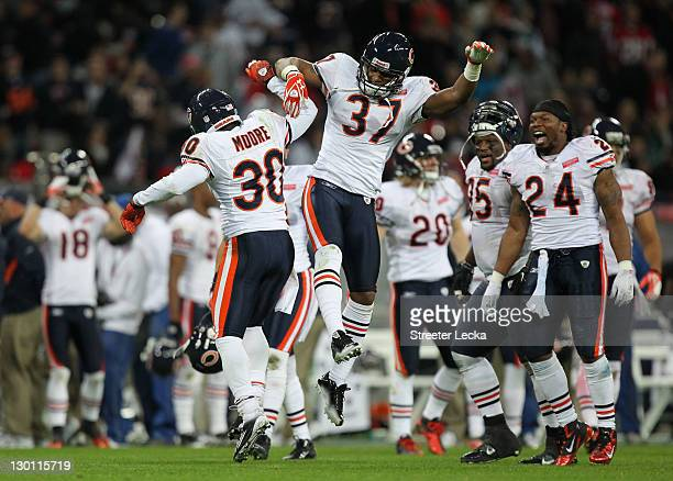 J Moore of the Chicago Bears celebrates Anthony Walters of the Chicago Bears after he makes a game winning interception during the NFL International...
