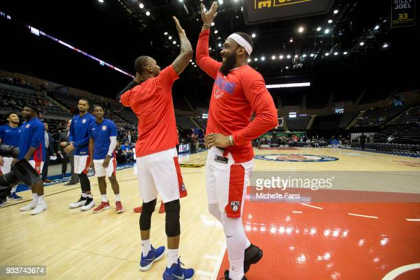Moore of the Long Island Nets high fives teammate before the game against the Greensboro Swarm on March 18 2018 at NYCB Live Home of the Nassau...