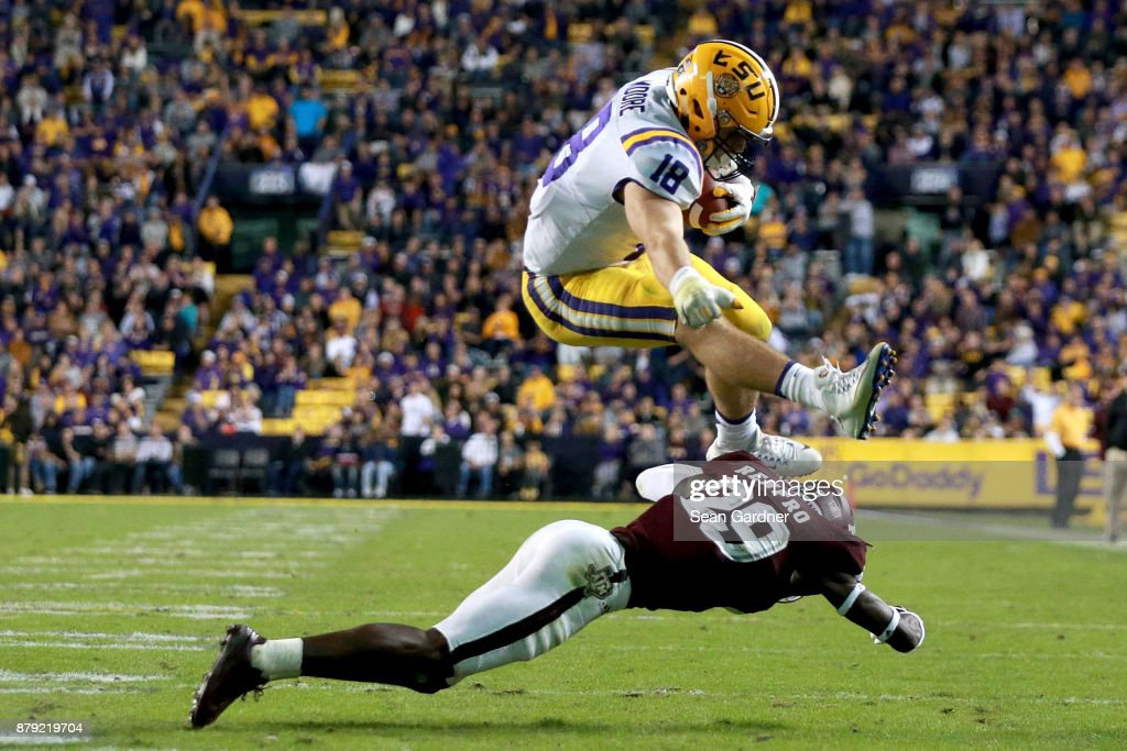 J.D. Moore #18 of the LSU Tigers hurdles Debione Renfro #29 of the Texas A&M Aggies during the second half of a game at Tiger Stadium on November 25, 2017 in Baton Rouge, Louisiana. LSU won the game 45 - 21.