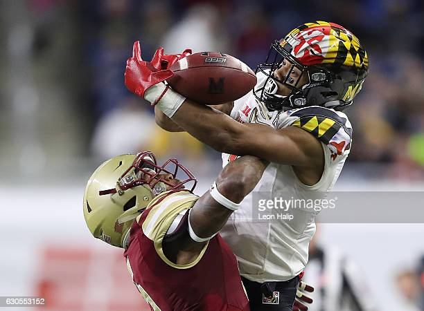 J Moore of the Maryland Terrapins and Kamrin Moore of the Boston College Eagles battle for the ball during the second quarter of the game at Ford...
